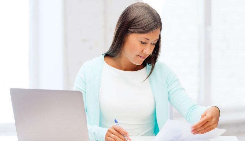 Woman-Preparing-Taxes