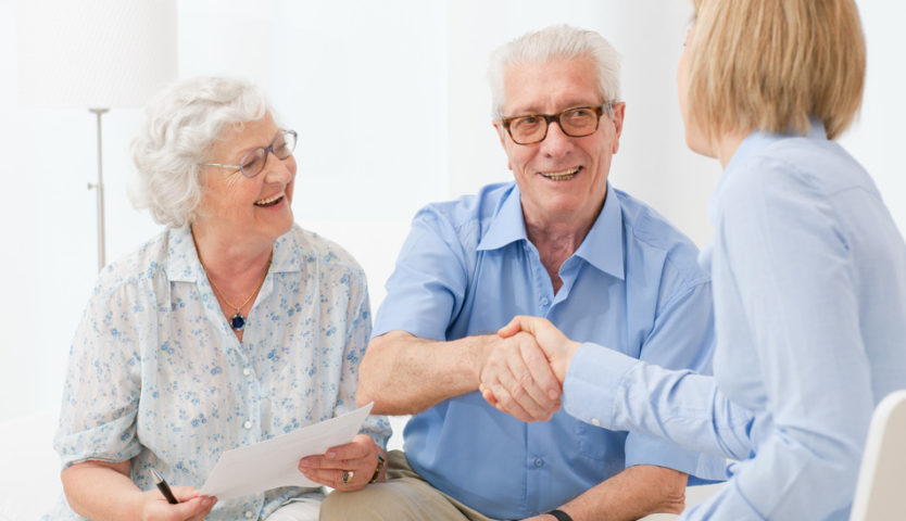 accountant-shaking-hands-with-retired-couple