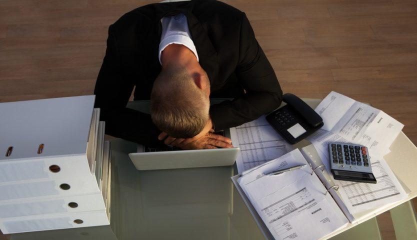 accountant-sleeping-on-a-laptop