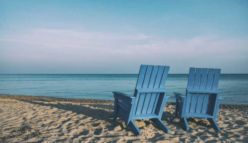 two-chairs-sitting-on-the-beach