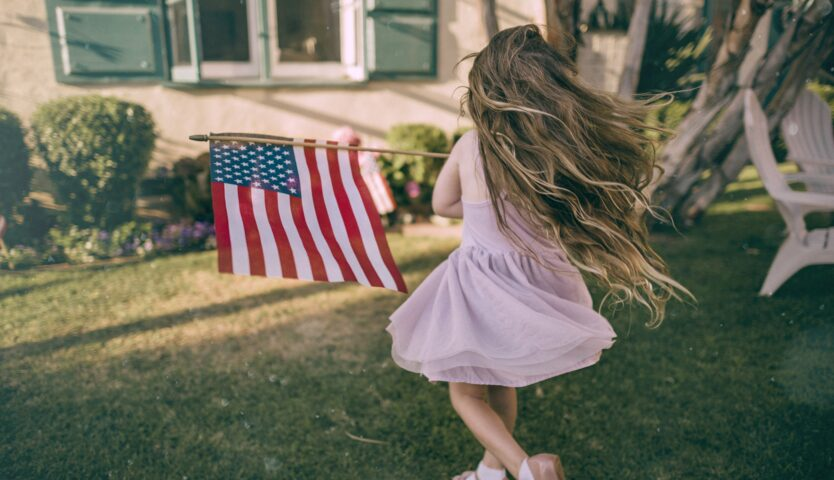 american-girl-living-in-canada-flying-american-flag