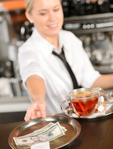 a-waitress-giving-back-change