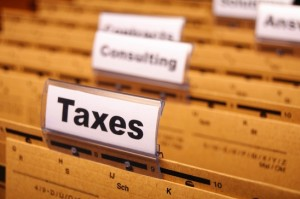 taxes with word on business folder index