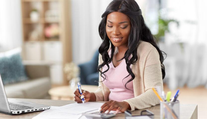 woman sitting at desk filing taxes
